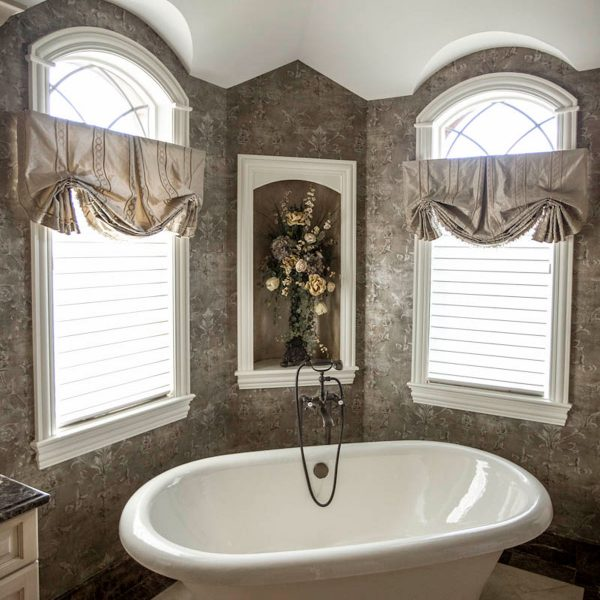 custom window treatments in master bathroom