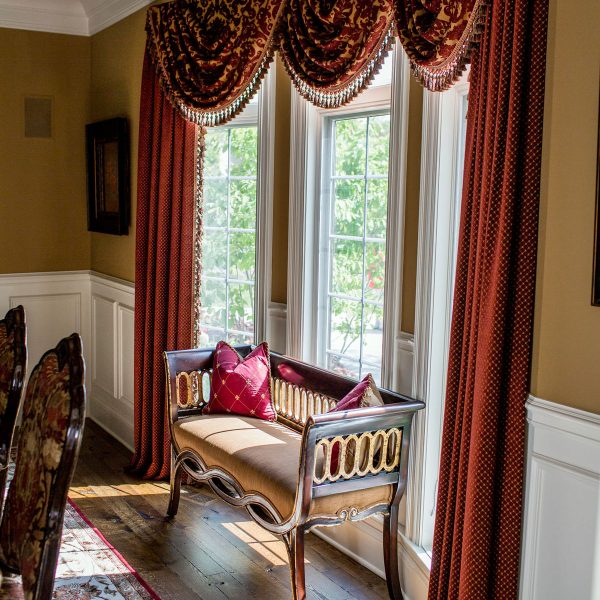red custom window treatments in dining room