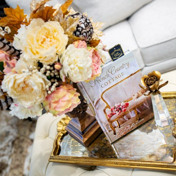 Handcrafted silk floral arrangement and designer book setting