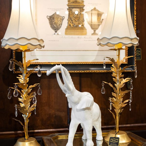 Luxury gold accent lamps and white glass elephant