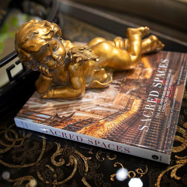 Gold cherub statue and luxury home decor