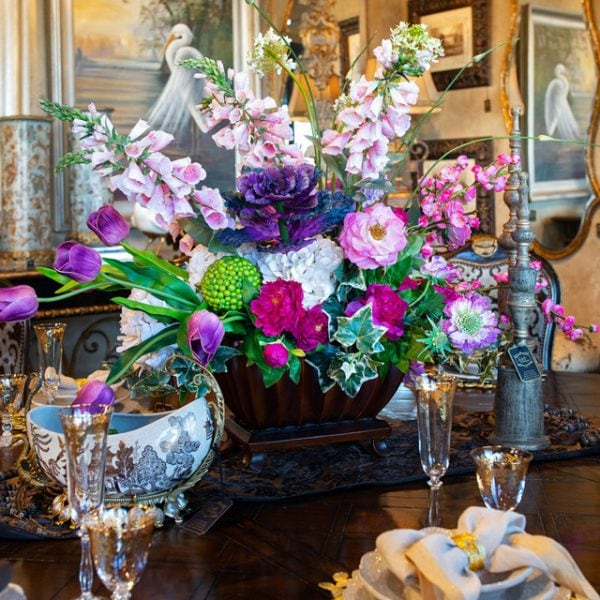 Colorful handcrafted custom spring flower arrangement centerpiece on a marge carson dining room table