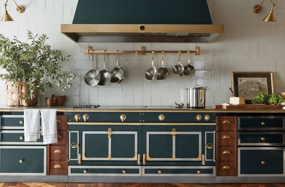 La Cornue Luxury Emerald Green and Gold French Kitchen Range Cooking in the Oven with Stainless Steel and Natural Wood cabinets