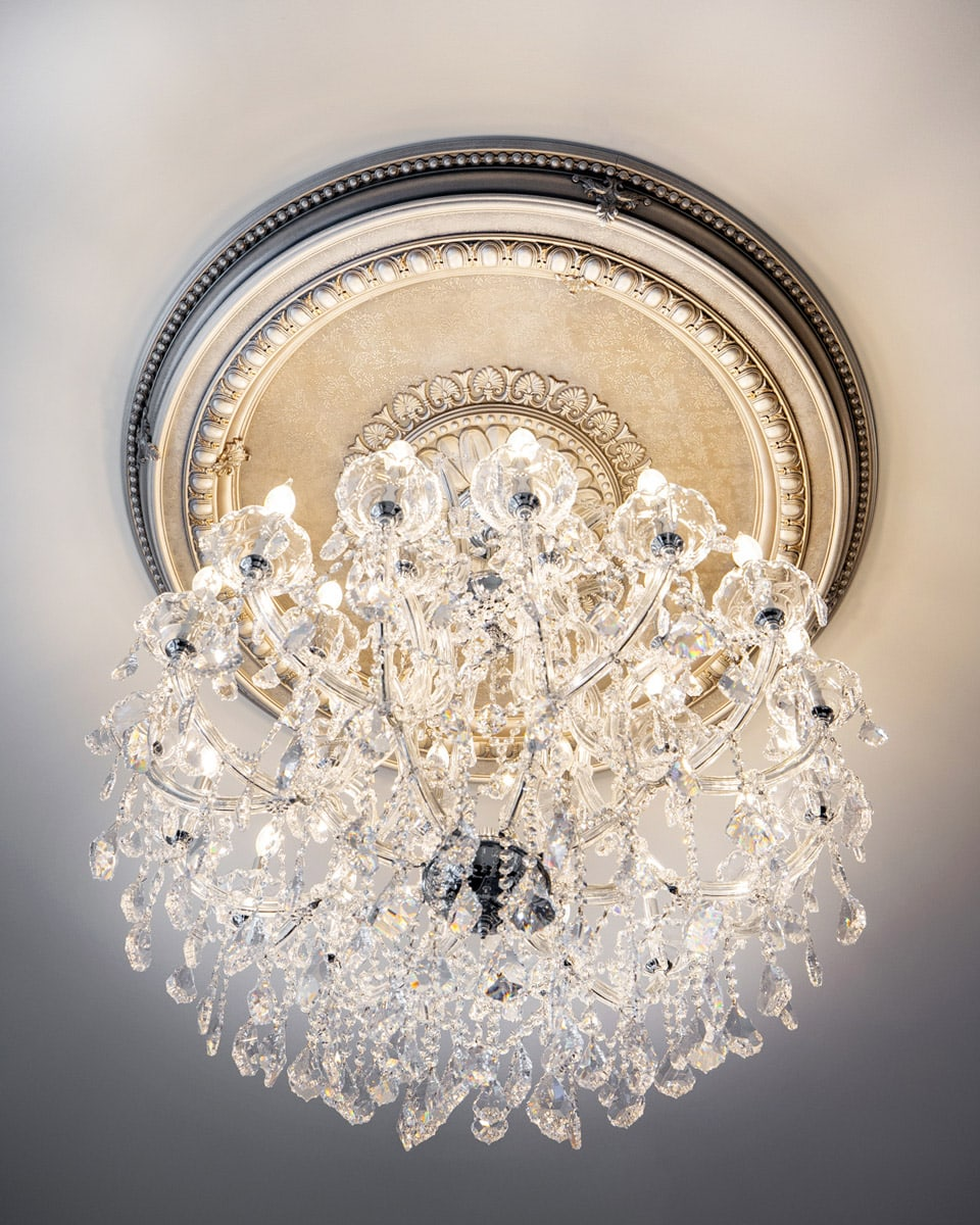 Master Bedroom Hand Painted Decorative Ceiling Medallion with a White Crystal and Glass Chandelier